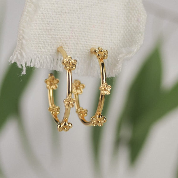 gold blossom flower hoop earrings