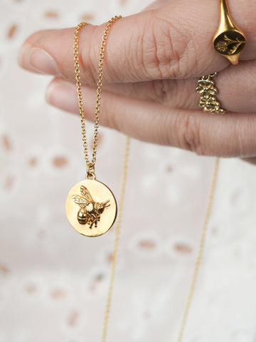 Gold bee coin necklace for layering
