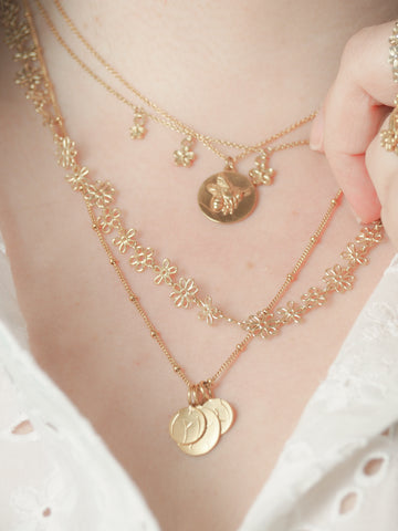 Gold bee coin necklace with flower necklaces