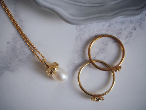 Gold Pearl Acorn Necklace and Flower Stacking Rings Rachel Whitehead Jewellery