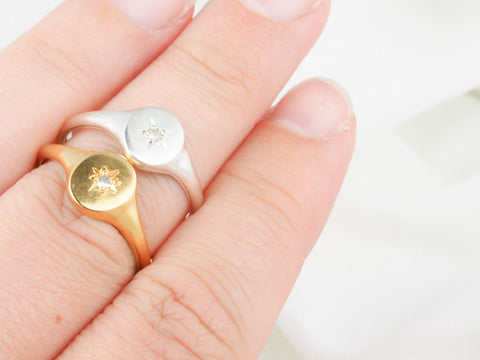 gold and silver star signet ring
