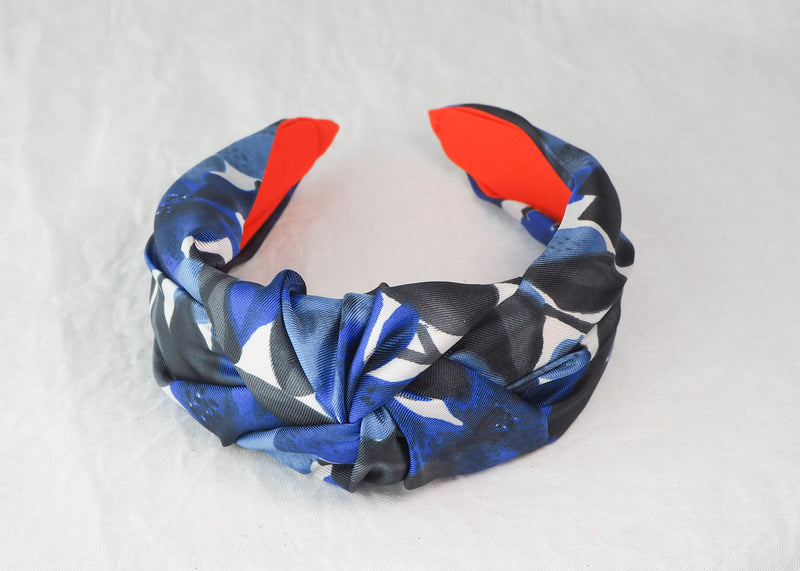 a wide knotted headband made from blue, white and black vintage satin fabric