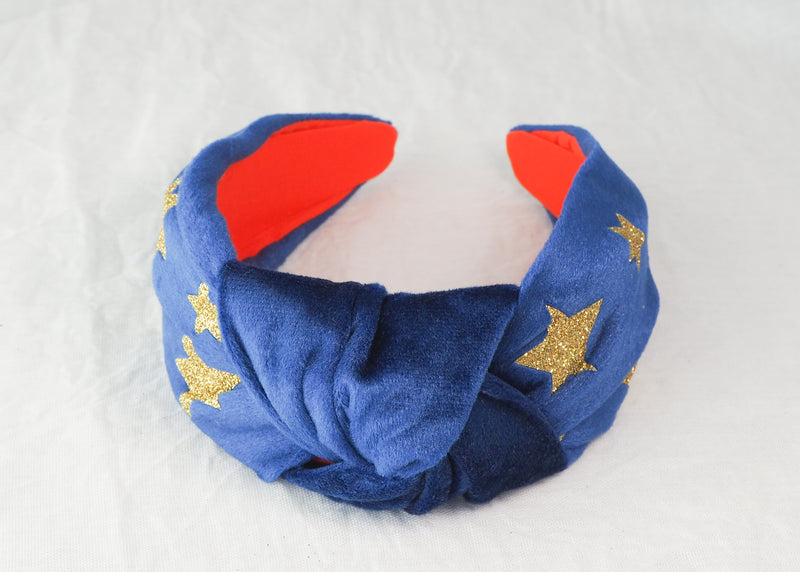 a star print headband made from blue velvet with gold glitter stars