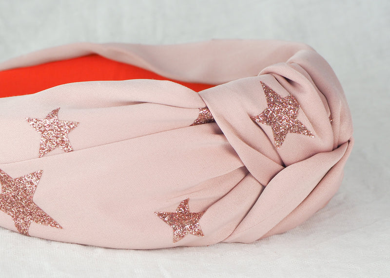light pink satin wide knotted headband with glitter stars