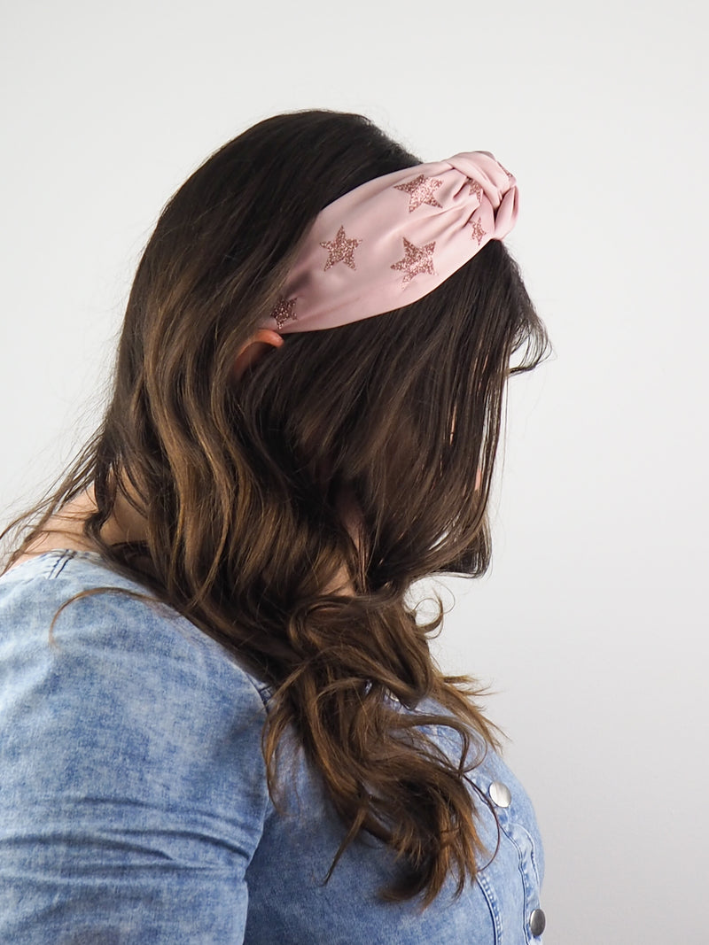 rose pink satin wide knotted headband with pink glitter stars printed on the fabric