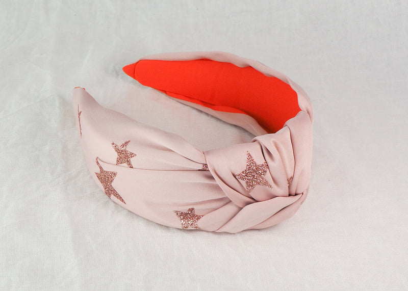 blush pink wide knot headband with printed rose coloured glitter stars