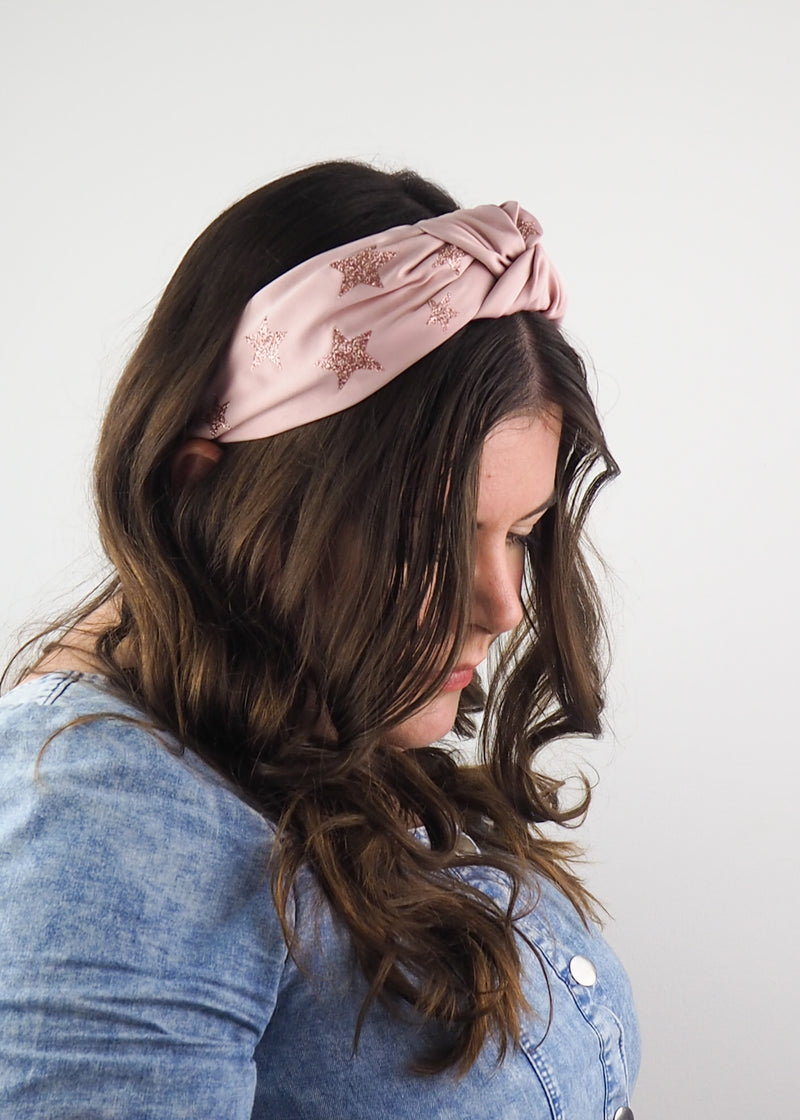 light pink satin wide knotted headband with pink glitter stars print