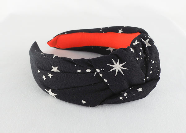 a black and white star print wide knotted headband made from deadstock fabric in birmingham
