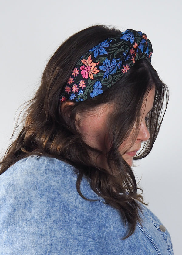 dark floral wide knotted headband made from woven jacquard fabric