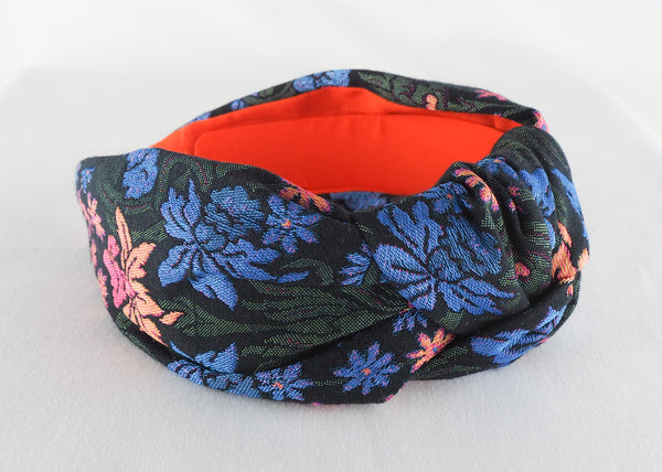 Dark floral daffodil wide knotted headband made from jacquard woven fabric