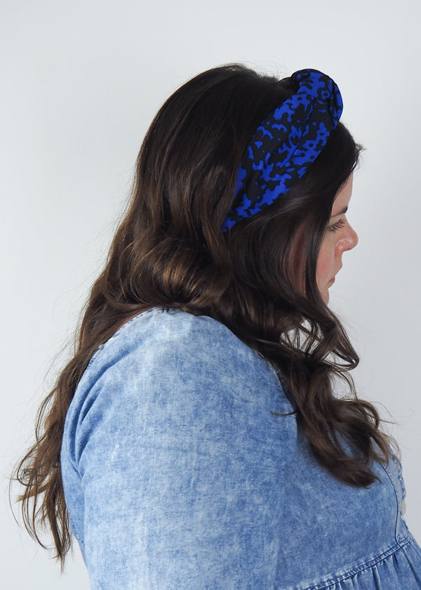 blue and black wide knot headband with mottled print