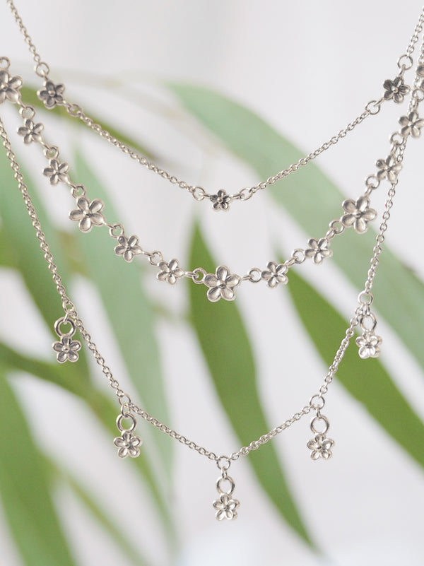 Silver blossom flower dangle necklace
