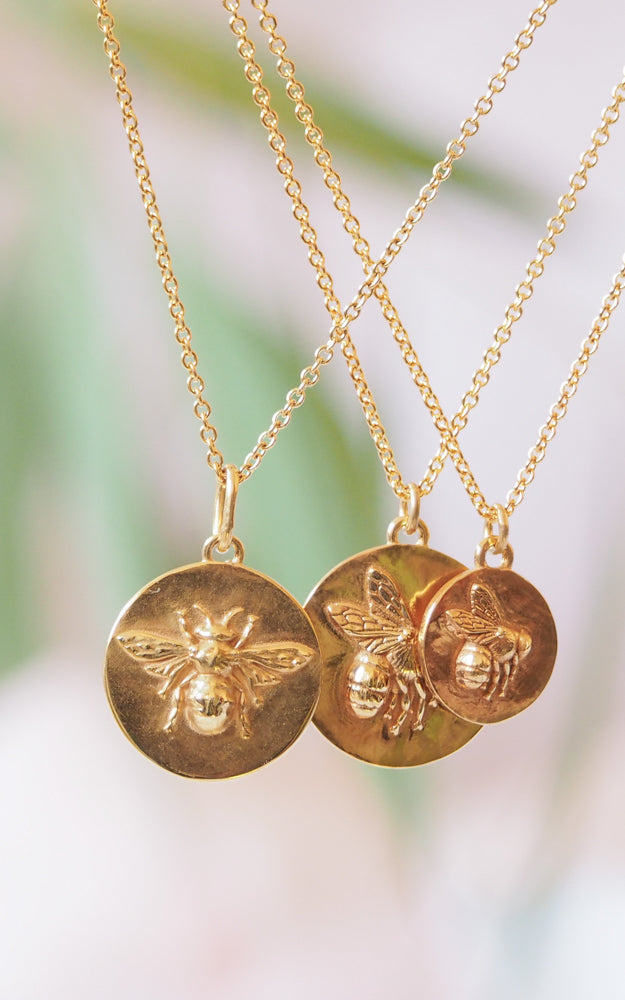 gold flying bee coin necklace