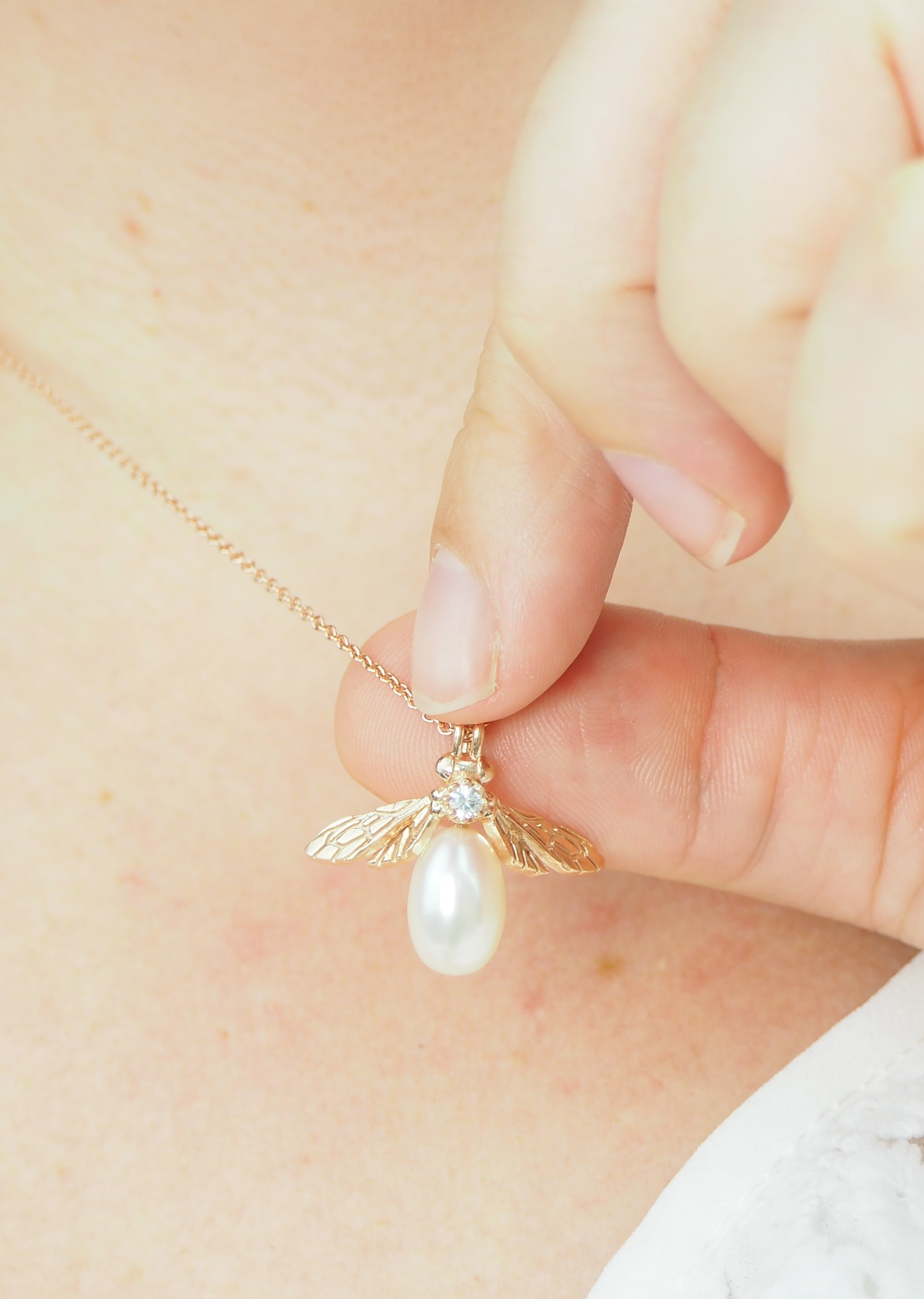 rose gold pearl bee necklace with white sapphire