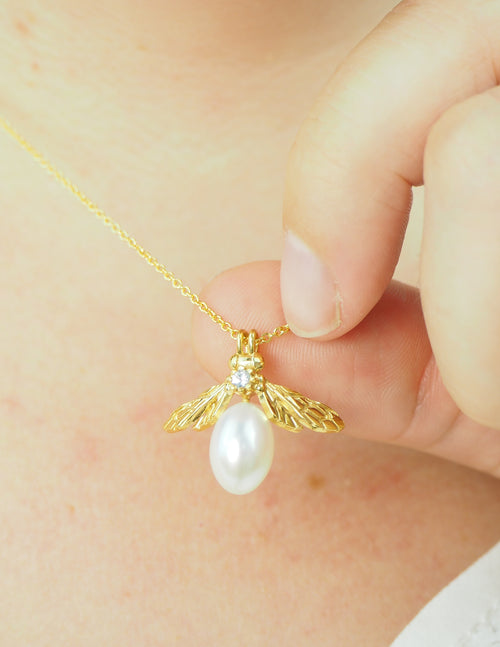 yellow gold pearl bee necklace with white sapphire