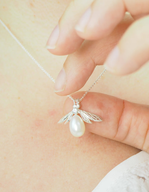 sterling silver pearl bee necklace with white sapphire