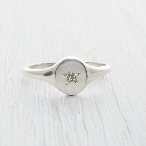 silver star set signet ring