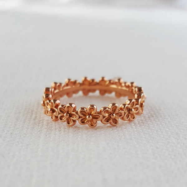rose gold small flower eternity stacking ring
