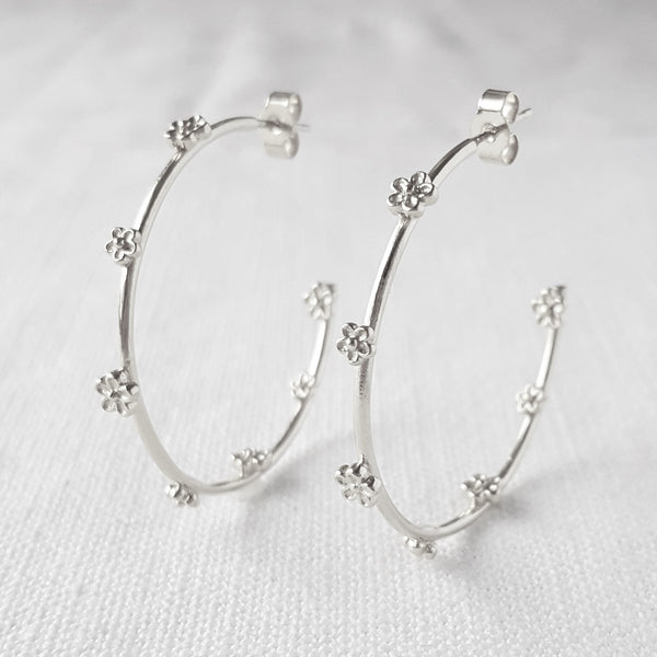 silver blossom flower hoop earrings
