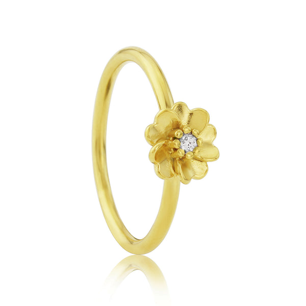 Gold vermeil wild rose flower stacking ring with white sapphire gemstone
