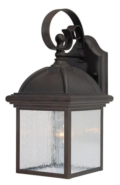 One-Light Outdoor Wall Lantern, Textured Rust Patina Finish on Cast Aluminum with Clear Seeded Glass Panels - Lighting Getz