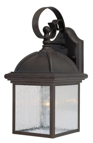 One-Light Outdoor Wall Lantern, Textured Rust Patina Finish on Cast Aluminum with Clear Seeded Glass Panels
