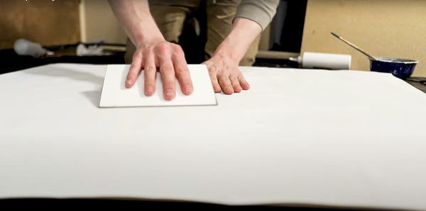 securing the canvas to the panel