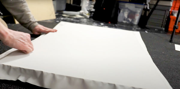 putting canvas back down after adding more adhesive