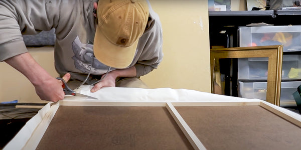 cutting excess overhanging canvas edge