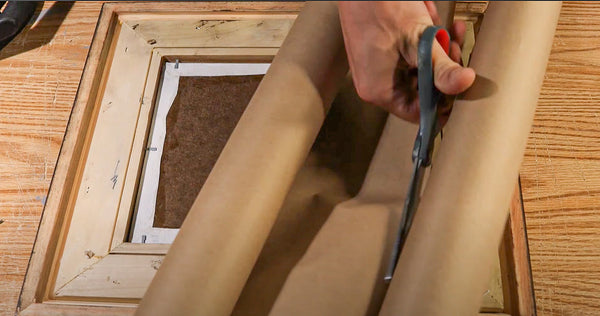use pH neutral, acid free brown paper to use as a presentable backing for your framed artwork