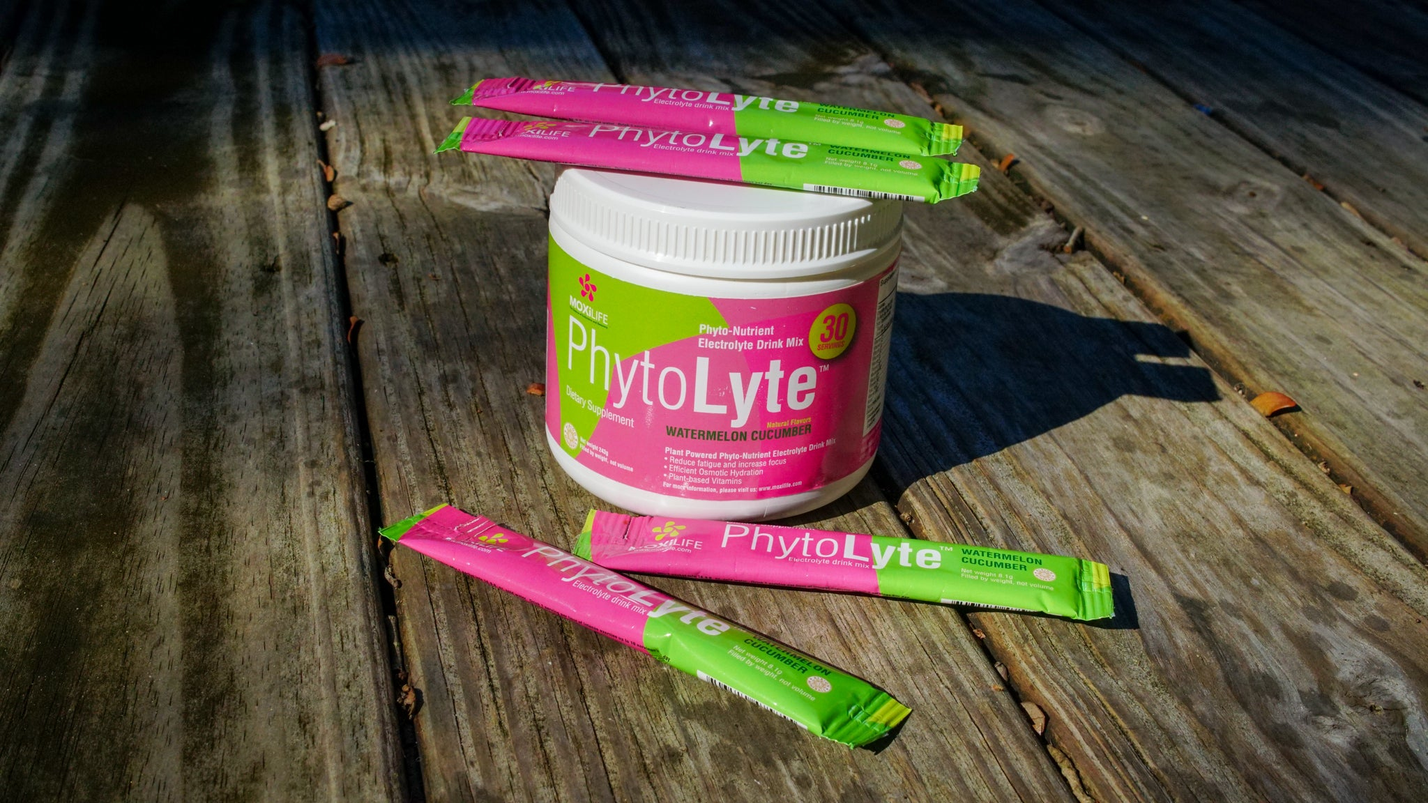PhytoLyte Tub and Stickpack single servings on wood deck outdoors