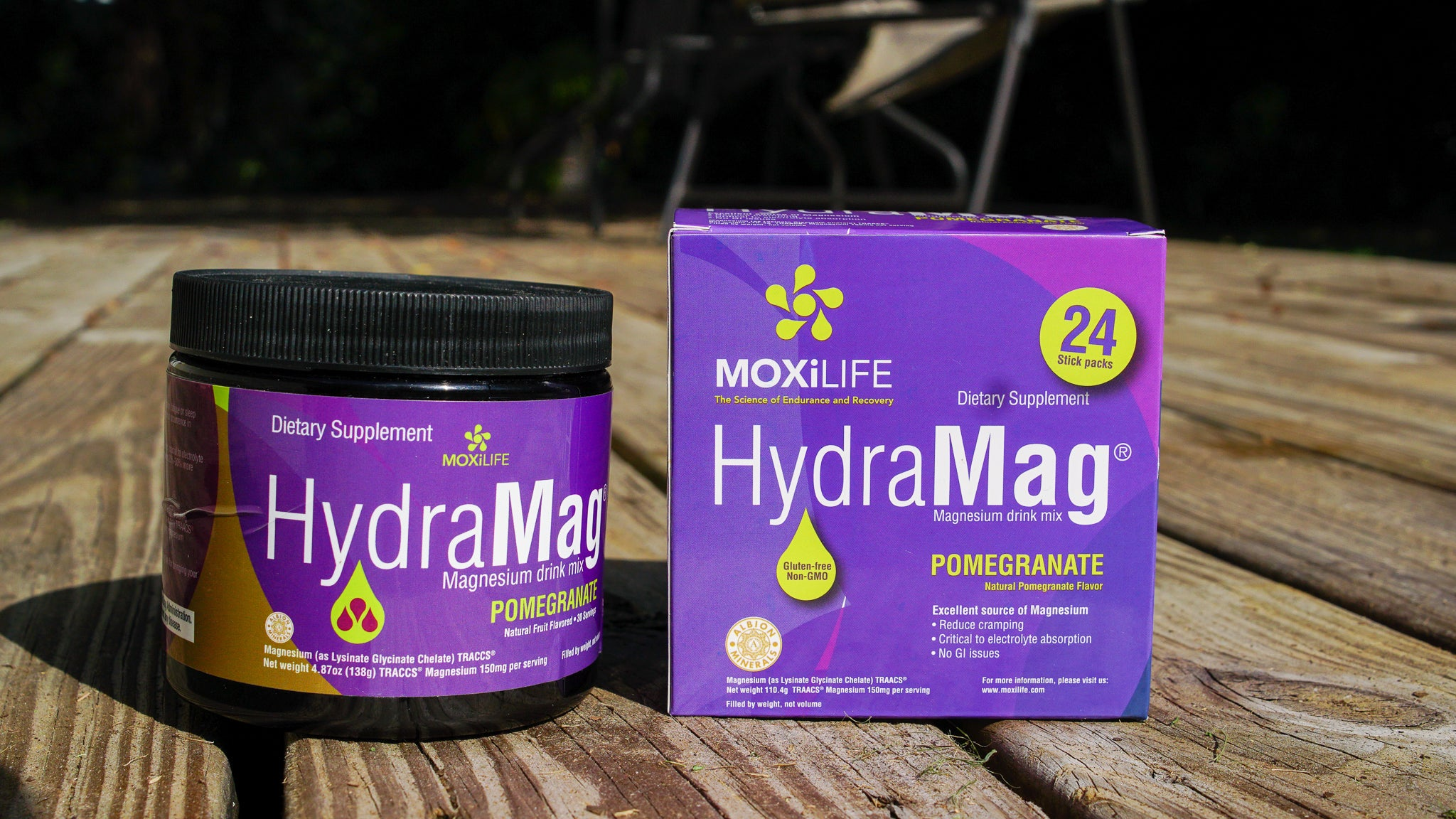 HydraMag 30 serving tub and a 24 serving box of stickpacks sitting on wooden deck outdoors