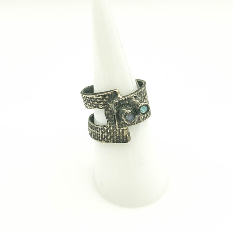 Ring with cutout and double moonstones.