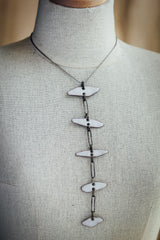 Enamel Spine with Oxidized Silver on chain