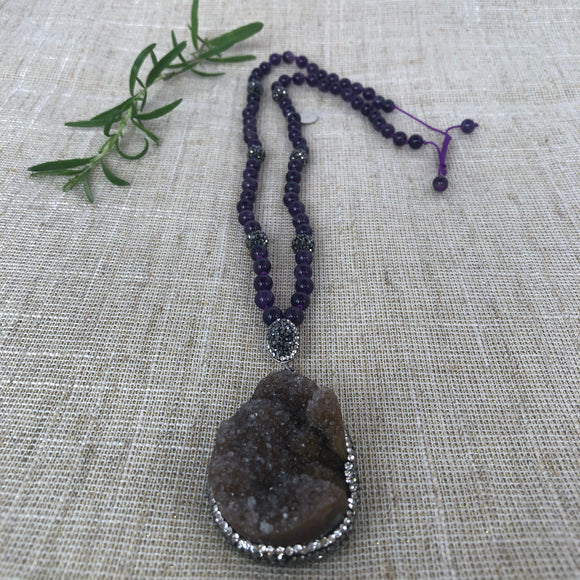 Hand knotted amethyst necklace with druzy pendant