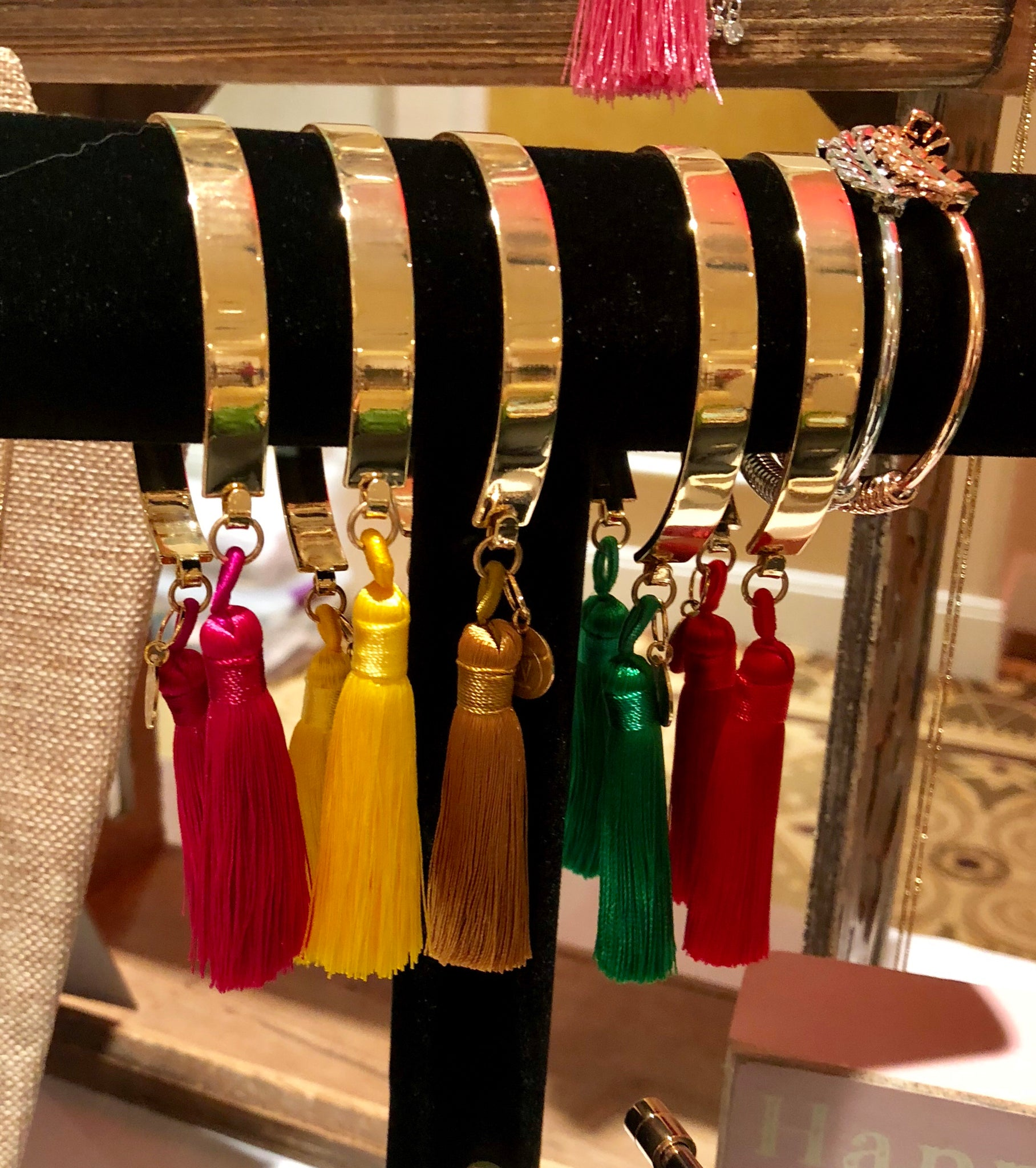 Golden open bangle with tassels