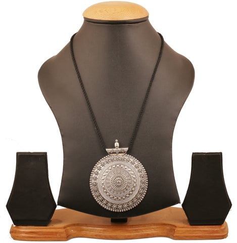 Touchstone Statement Intricately Embossed Mandala Pendant in Cotton Tassel in Antique Silver Tone for Women