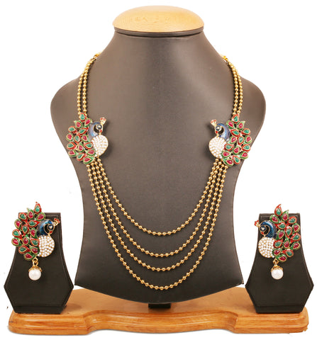 Touchstone Indian Bollywood ethnic peacock meenakari enamel red faux ruby green faux emerald and faux pearls long bridal chandelier designer jewelry necklace set for women in antique  gold tone.