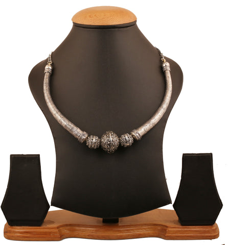Touchstone Indian Bollywood artistic and ethnic torque wire  and curved bead designer bridal jewelry hasli  necklace for women in antique oxidized silver tone.