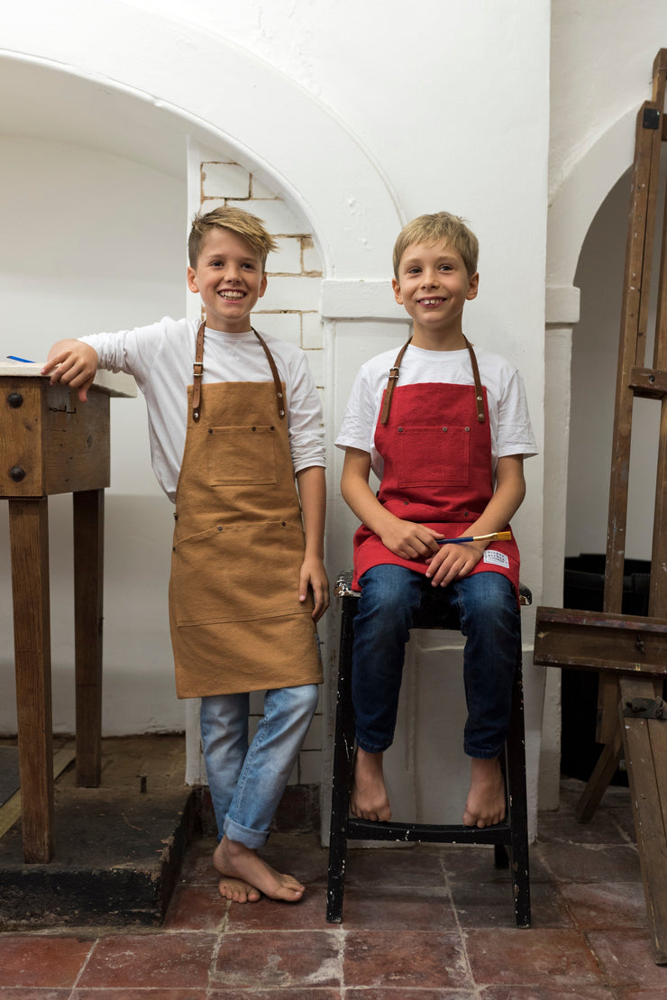 british design handmade children's aprons with leather straps risdon and risdon pink navy trade brown heritage grey denim shropshire green factory red