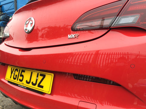 Flush fit parking sensors fitted to an Astra VXR in Power Red
