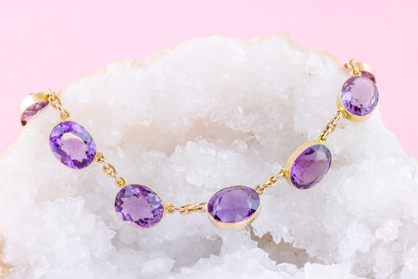 A 15ct gold amethyst riviere necklace