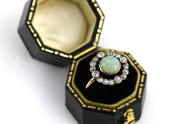 An antique 18ct gold opal and diamond cluster ring