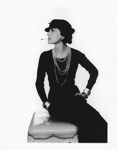 Coco Chanel with pearl necklaces in her black dress