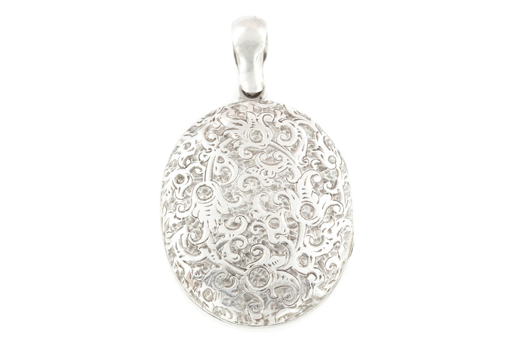 Victorian Silver Oval Locket with Ornate Engraving