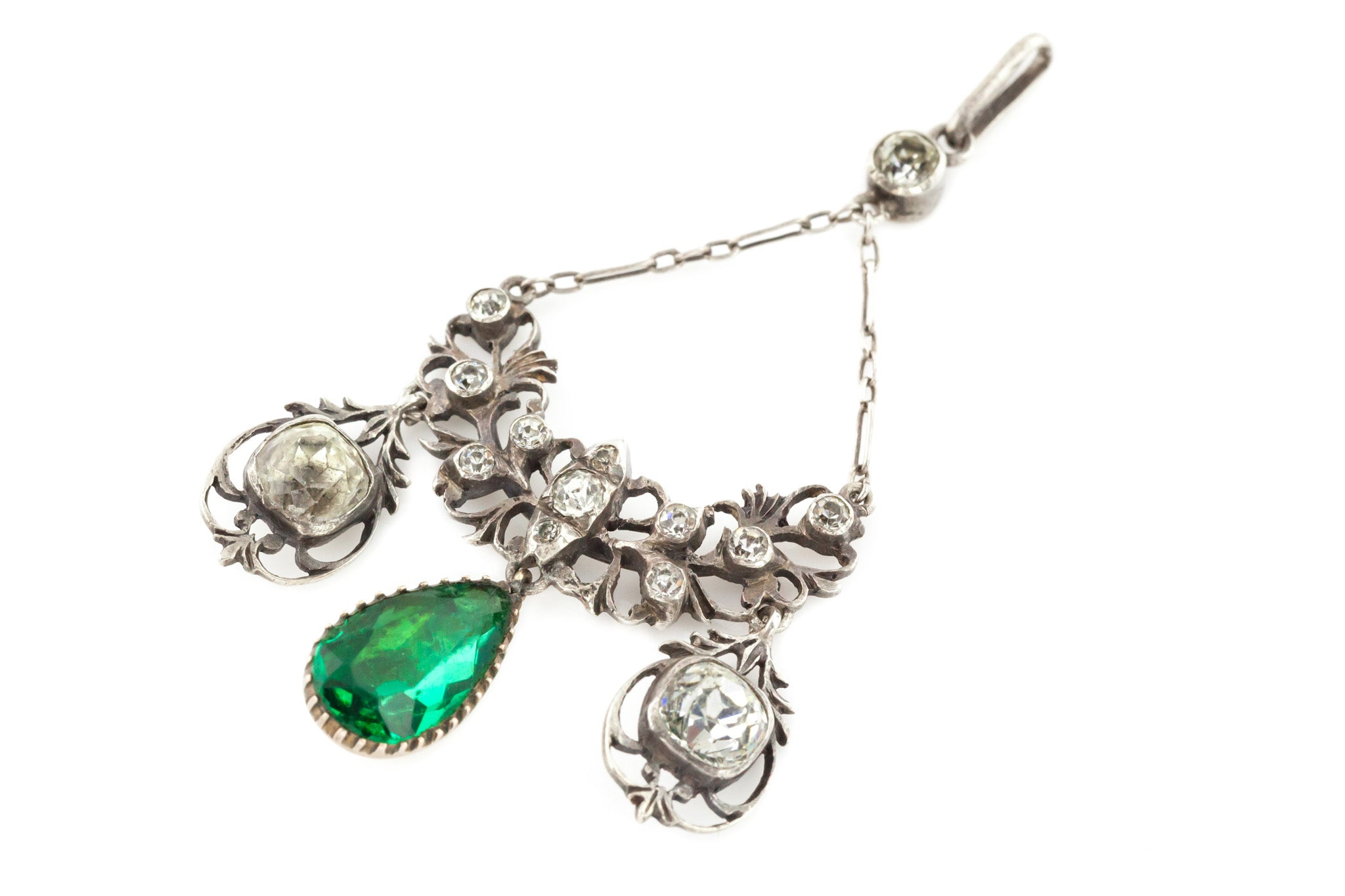 A small pendant with emerald and silver stones