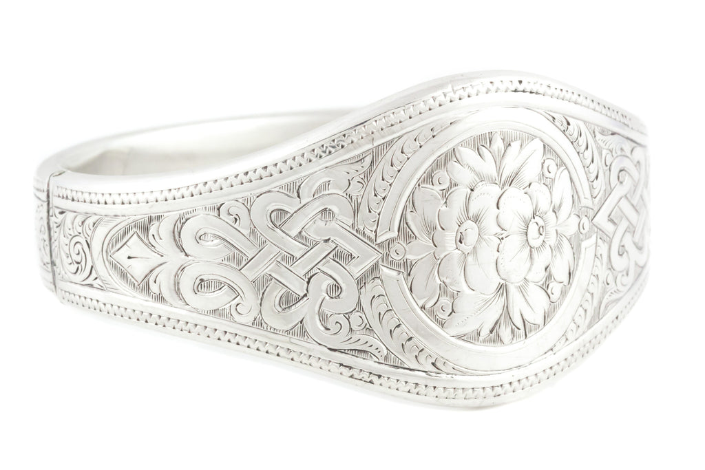 Exquisite Victorian Silver Bangle with Celtic Motif and Curved Body