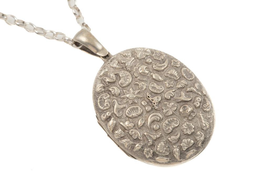 "Large Victorian Silver Repoussé Locket with 24"" Chain"