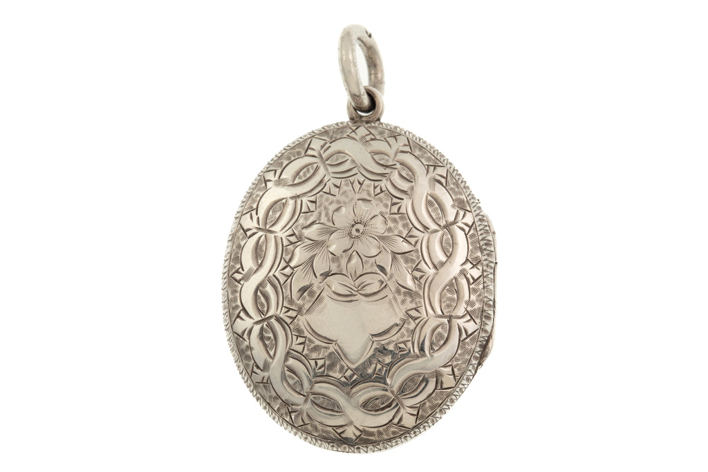 Antique Silver Engraved Oval Locket, c.1882.
