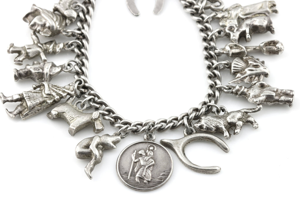 Fine Quality Antique Vintage Silver Charm Bracelet - (with 24 Silver Charms)